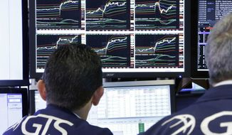 FILE- In this Aug. 21, 2018, file photo specialist Peter Mazza, left, works at his post on the floor of the New York Stock Exchange. The U.S. stock market opens at 9:30 a.m. EDT on Tuesday, Sept. 18. (AP Photo/Richard Drew, File)