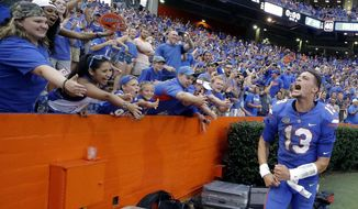 FILE - In this Sept. 16, 2017, file photo, Florida quarterback Feleipe Franks (13) celebrates with fans after he threw a 63-yard touchdown pass as time expired to defeat Tennessee 26-20 in an NCAA college football game, in Gainesville, Fla. Franks still gets goosebumps every time he sees a replay. (AP Photo/John Raoux, File)