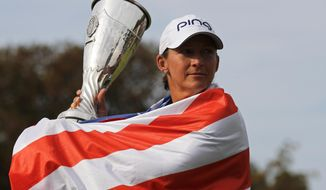 Angela Stanford of the U.S. poses with her trophy after winning the Evian Championship women's golf tournament in Evian, eastern France, Sunday, Sept. 16, 2018. (AP Photo/Francois Mori)