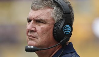 FILE - In this Sept. 15, 2018, file photo, Georgia Tech head coach Paul Johnson watches from the sideline as his team plays against Pittsburgh in an NCAA football game, in Pittsburgh. Georgia Tech is reeling from two straight losses that easily could've gone the other way. Now, with No. 3 Clemson heading to Atlanta, the Yellow Jackets are facing the very real possibility of their worst start since 2003, which would surely turn up the heat on coach Paul Johnson.(AP Photo/Keith Srakocic, File)