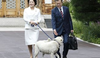 South Korean President Moon Jae-in and his wife Kim Jung-sook leave the presidential Blue House in Seoul, South Korea to the airport for a  visit to Pyongyang, North Korea, Tuesday, Sept. 18, 2018. (Pyongyang Press Corps Pool via AP)