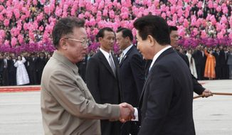 FILE - In this Oct. 2, 2007, file photo, South Korean President Roh Moo-hyun, right, shakes hands with North Korean leader Kim Jong Il, left, in Pyongyang, North Korea. In pursuing engagement with North Korean leader Kim Jong Un to defuse a nuclear crisis, South Korean President Moon Jae-in is also looking to bolster the legacy of his late friend and political mentor, former President Roh Moo-hyun, whose ambitious efforts to build trust with North Korea crumbled as it began building its nuclear arsenal a decade ago. (Korea Pool/Yonhap via AP, File)