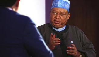 OPEC Secretary-General Mohammed Sanusi Barkindo speaks at an event in Fujairah, United Arab Emirates, Tuesday, Sept. 18, 2018. The head of OPEC said that the oil cartel must stick together for the good of the global economy amid Iran facing renewed U.S. sanctions. (AP Photo/Jon Gambrell)