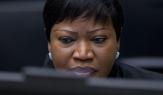 FILE - In this file photo dated Thursday, Jan. 28, 2016, Chief Prosecutor Fatou Bensouda waits for the start of the trial against former Ivory Coast president Laurent Gbagbo at the International Criminal Court in The Hague, Netherlands. Bensouda says she is launching a preliminary investigation to establish if there is enough evidence to merit a full-blown investigation into deportations of hundreds of thousands of Rohingya Muslims from Myanmar into Bangladesh. (AP Photo/Peter Dejong)