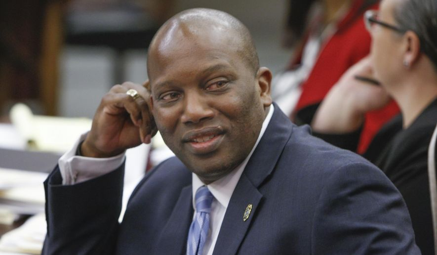 In this April 10, 2017 photo, 5th district Circuit Solicitor Dan Johnson confers with colleagues during a hearing in Richland County Court. Johnson was indicted Tuesday, Sept. 18, 2018 on more than two dozen charges related to the misspending of public funds on trips to foreign countries including the Netherlands and the Galapagos Islands. (Tracy Glantz/The State via AP)