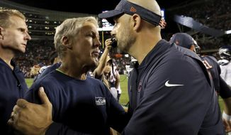 Seattle Seahawks head coach Pete Carroll, left, and Chicago Bears head coach Matt Nagy greet each other after an NFL football game Monday, Sept. 17, 2018, in Chicago. The Bears won 24-17. (AP Photo/Nam Y. Huh)