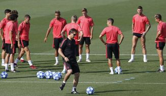 Real Madrid coach Julen Lopetegui kicks a ball during a training session in Madrid, Spain, Tuesday Sept. 18, 2018. Real Madrid will play Roma in a Group G Champions League soccer match on Wednesday. (AP Photo/Paul White)