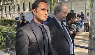 Herve Falciani, left, leaves the national court after an extradition hearing in Madrid, Spain, Tuesday, Sept. 11, 2018. A former HSBC employee convicted of economic espionage in Switzerland is resisting extradition from Spain, arguing that his massive data leak from the bank's Geneva subsidiary led to dozens of judicial tax evasion probes worldwide.  (AP Photo/Aritz Parra)