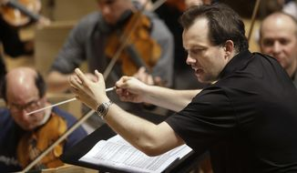 FILE- In this Nov. 20, 2014, file photo, Boston Symphony Orchestra music director Andris Nelsons rehearses at Symphony Hall, in Boston. The world-renowned orchestra nearly missed the last stop on its European tour Monday, Sept. 17, 2018, after getting stuck in Paris. Orchestra brass say they had to scramble to get enough musicians to Amsterdam for the tour finale, leaving some stranded in the French capital and forcing music director Andris Nelsons and others to hastily redo the program. (AP Photo/Steven Senne, File)