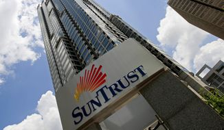This May 7, 2009, file photo shows the SunTrust headquarters building in Atlanta. (AP Photo/John Bazemore, File)