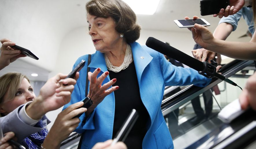 Sen. Dianne Feinstein, D-Calif., is surrounded by reporters as she arrives for a vote, Tuesday, Sept. 18, 2018, on Capitol Hill in Washington. (AP Photo/Jacquelyn Martin)