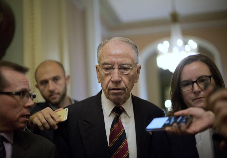 Sen. Chuck Grassley, R-Iowa, walks past members of the media as he heads to the Senate Chamber floor on Capitol Hill in Washington, Tuesday, Sept. 18, 2018. (AP Photo/Pablo Martinez Monsivais) ** FILE **