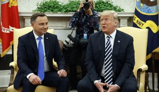 President Donald Trump speaks during a meeting with Polish President Andrzej Duda during a meeting in the Oval Office of the White House, Tuesday, Sept. 18, 2018, in Washington. (AP Photo/Evan Vucci)