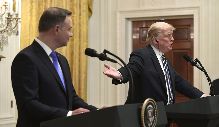 President Donald Trump, right, talks about NATO as he gestures to Polish President Andrzej Duda, left, during a news conference in the East Room of the White House in Washington, Tuesday, Sept. 18, 2018. (AP Photo/Susan Walsh) **FILE**