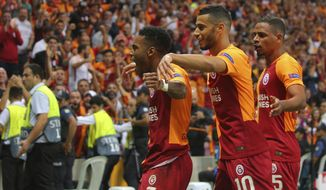 Galatasaray's forward Garry Rodrigues, left, celebrates after scoring against Lokomotiv Moscow during the Champions League Group D soccer match between Galatasaray and Lokomotiv Moscow in Istanbul, Tuesday, Sept. 18, 2018. (AP Photo)
