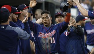 Minnesota Twins' Jorge Polanco (11) is congratulated after scoring during the sixth inning of the team's baseball game against the Detroit Tigers in Detroit, Tuesday, Sept. 18, 2018. (AP Photo/Paul Sancya)