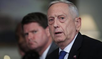 Defense Secretary Jim Mattis responds to a reporter's question during a meeting with and Philippine Secretary of National Defense Delfin Lorenzana at the Pentagon, Tuesday, Sept. 18, 2018. (AP Photo/Manuel Balce Ceneta)