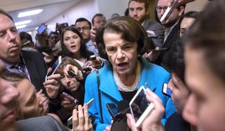 Sen. Dianne Feinstein is surrounded by reporters, all seeking her commentary on Supreme Court nominee Judge Brett M. Kavanaugh. and the challenges he now faces. (AP Photo/J. Scott Applewhite) (Associated Press)