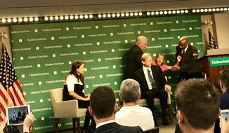 "A lone anti-war activist from ""Code Pink"" disrupted an event at the Hudson Institute think tank in Washington, where U.S. Special Envoy to Iran Brian Hook was outlining the Trump administration's plan to increase sanctions on Tehran, on Wednesday, Sept. 19, 2018. The protester yelled, ""No more war, peace with Iran,"" before being removed by security. (The Washington Times/Guy Taylor)"