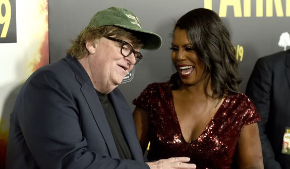 """Michael Moore, left, and Omarosa Manigault Newman talk on the red carpet as they arrive at the premiere of """"Fahrenheit 11/9"""" on Wednesday, Sept. 19, 2018, at the Samuel Goldwyn Theater in Beverly Hills, Calif. (Photo by Chris Pizzello/Invision/AP)"""