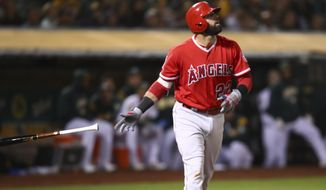 Los Angeles Angels' Kaleb Cowart tosses his bat as he watches his grand slam off Oakland Athletics' Lou Trivino during the sixth inning of a baseball game Tuesday, Sept. 18, 2018, in Oakland, Calif. (AP Photo/Ben Margot)