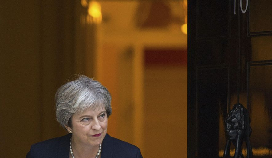 Britain's Prime Minister Theresa May waits to greet her Maltese counterpart Joseph Muscat to 10 Downing Street in London ahead of talks, Monday Sept. 17, 2018. (Dominic Lipinski/PA via AP)