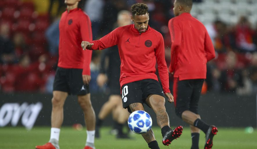 PSG's Neymar warms up ahead of the Champions League Group C soccer match between Liverpool and Paris-Saint-Germain at Anfield stadium in Liverpool, England, Tuesday, Sept. 18, 2018. (AP Photo/Dave Thompson)