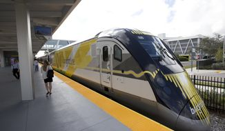 FILE - In this Jan. 11, 2018 file photo a Brightline train is shown at the station, in Fort Lauderdale, Fla. A plan to build a high-speed train between Southern California and Las Vegas is back on track now that a private rail company has taken over the project. Brightline announced Wednesday, Sept. 19, 2018, that it has acquired the rights to XpressWest's 185-mile federally approved rail corridor along Interstate 15.  (AP Photo/Wilfredo Lee,File)