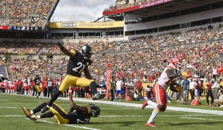 Pittsburgh Steelers safety Sean Davis (21) leaps over teammate Artie Burns, bottom, as Kansas City Chiefs wide receiver Tyreek Hill (10) goes in for a touchdown after making a catch in the second half of an NFL football game, Sunday, Sept. 16, 2018, in Pittsburgh. (AP Photo/Don Wright)