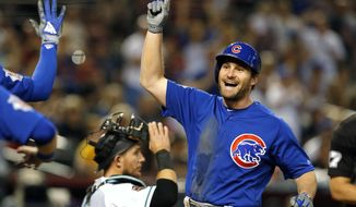 Chicago Cubs' Daniel Murphy celebrates after hitting a two-run home run against the Arizona Diamondbacks in the second inning during a baseball game, Tuesday, Sept. 18, 2018, in Phoenix. (AP Photo/Rick Scuteri)