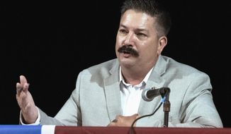 FILE - In this July 8, 2018, file photo, Randy Bryce, a Wisconsin Democratic candidate for the U.S. House, answers a question during a debate in Lake Geneva, Wis. Bryce's mother, Nancy Bryce, is calling for an attack ad featuring Randy's brother James to be taken off the air. The ad was unveiled Tuesday, Sept. 18 by a Republican super PAC linked to House Speaker Paul Ryan. Bryce is running against Republican Bryan Steil to replace Ryan in the southeast Wisconsin congressional district. (Angela Major /The Janesville Gazette via AP)