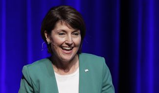 U.S. Rep. Cathy McMorris Rodgers, R-Spokane, who is being challenged by Democrat Lisa Brown, smiles during a debate with Brown, Wednesday, Sept. 19, 2018, in Spokane, Wash. (AP Photo/Ted S. Warren)