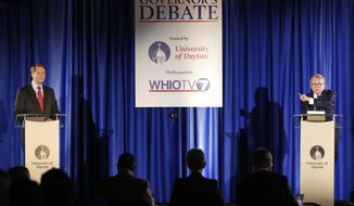 Gubernatorial candidates, Republican Mike DeWine, right, and his opponent Democrat Richard Cordray, left, speak during a debate at the University of Dayton on Wednesday, Sept. 19, 2018, in Dayton, Ohio. Future debates are scheduled for Oct. 1 in Marietta and Oct. 8 in Cleveland ahead of the November election. (Ty Greenless/Dayton Daily News via AP)