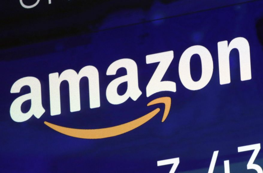 In this Friday, July 27, 2018, file photo, the logo for Amazon is displayed on a screen at the Nasdaq MarketSite.  (AP Photo/Richard Drew, FILE)