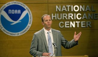 FILE- In this May 30, 2018 file photo, FEMA Administrator Brock Long speaks during a news conference at the National Hurricane Center in Miami. According to a story published in the Wall Street Journal, Long is being investigated by Homeland Security's internal watchdog and a congressional committee for the possible misuse of government vehicles. (AP Photo/Wilfredo Lee, File)