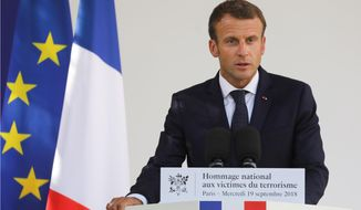 French President Emmanuel Macron delivers a speech during a national ceremony to pay tribute to the victims of terrorism, at the Invalides in Paris, France, Wednesday, Sept. 19, 2018. French President Emmanuel Macron has pledged to create a Memorial Museum to honor the victims of terrorism. (Ludovic Marin/Pool Photo via AP)