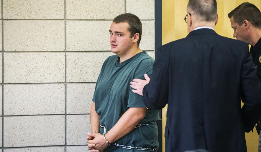 Collin Daniel Richards makes his initial court appearance after being charged with the murder of Iowa State golfer Celia Barquin Arozamena, on Tuesday, Sept. 18, 2018, at the Story County Courthouse in Nevada, Iowa. (Kelsey Kremer/The Des Moines Register via AP)