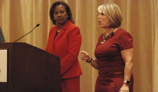 Congresswoman Michelle Lujan Grisham, right, and moderator Marilyn Pettes Hill attend a gubernatorial candidate forum organized by the NAACP and an associated sorority in Albuquerque, N.M., on Friday, Sept. 14, 2018. Lujan Grisham and Congressman Steve Pearce are competing to become the state's next governor, amid campaigning about solutions to poverty and improving public schools. GOP Gov. Susan Martinez cannot run for a third consecutive term. (AP Photo/Morgan Lee)