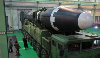 In this Nov. 29, 2017, photo provided by the North Korean government, North Korean leader Kim Jong-un (third from left) and what the North Korean government calls the Hwasong-15 intercontinental ballistic missile is seen in North Korea. This week's inter-Korean summit talks ended with a set of sweeping agreements on denuclearization of the Korean Peninsula, reducing a military standoff and other reconciliation issues.(Korean Central News Agency/Korea News Service via AP) **FILE**