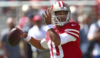 San Francisco 49ers quarterback Jimmy Garoppolo drops back to throw during the first half of an NFL football game against the Detroit Lions in Santa Clara, Calif., Sunday, Sept. 16, 2018. (AP Photo/Ben Margot)