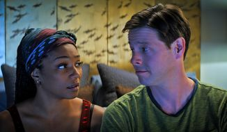 "This image released by Roadside Attractions shows Tiffany Haddish, left, and Ike Barinholtz in a scene from the comedy ""The Oath,"" which will be a part of the Los Angeles Film Festival, running from Sept. 20-28. (Topic Studios and Roadside Attractions via AP)"