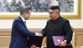 South Korean President Moon Jae-in, left, and North Korean leader Kim Jong-un shakes hands after signing the documents at the Paekhwawon State Guesthouse in Pyongyang, North Korea, Wednesday, Sept. 19, 2018. (Pyongyang Press Corps Pool via AP)