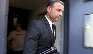 "FILE- In this Aug. 14, 2018, file photo actor Liev Schreiber leaves court in Nyack, N.Y., after appearing on a harassment charge. On Wednesday, Sept. 19, 2018, a New York judge has dismissed charges against Schreiber for allegedly attacking a photographer while the actor was filming the popular Showtime series ""Ray Donovan."" (Peter Carr/The Journal News via AP, File)"