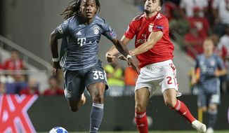 Benfica's Pizzi, right, and Bayern midfielder Renato Sanches fight for the ball during the Champions League group E soccer match between Benfica and Bayern Munich at the Luz stadium in Lisbon, Wednesday, Sept. 19, 2018. (AP Photo/Armando Franca)