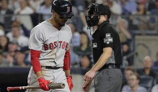 Boston Red Sox's Mookie Betts reacts after striking out during the fifth inning of the team's baseball game against the New York Yankees on Wednesday, Sept. 19, 2018, in New York. (AP Photo/Frank Franklin II)