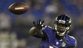 FILE - In this Aug. 9, 2018, file photo, Baltimore Ravens wide receiver Breshad Perriman prepares to catch a pass in the second half of a preseason NFL football game against the Los Angeles Rams in Baltimore. After losing two wide receivers to long-term injuries, the Washington Redskins saw a glaring need and signed Michael Floyd and Breshad Perriman this week in the hopes of giving quarterback Alex Smith and the offense more options. (AP Photo/Nick Wass, File)