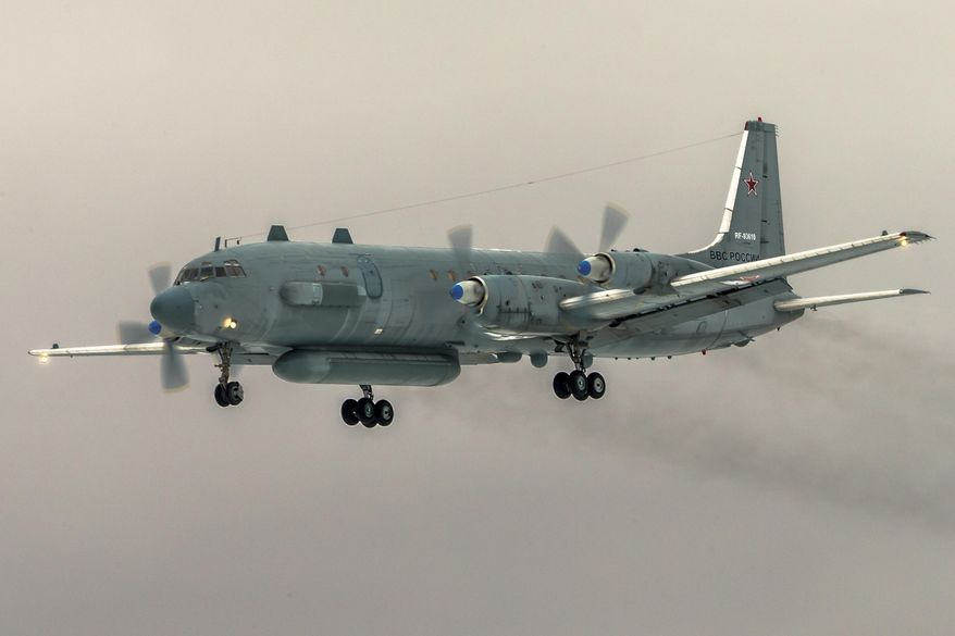 FILE In this file photo taken on Saturday, March 4, 2017, The Russian Il-20 electronic intelligence plane of the Russian air force with the registration number RF 93610, which was accidentally downed by Syrian forces responding to an Israeli air strike flays near Kubinka airport, outside Moscow, Russia. The Kremlin said that Russian President Vladimir Putin has accepted Israel's offer to share detailed information about the Israeli air raid that triggered the Syrian fire and led to the plane's loss. (AP Photo/Marina Lystseva)