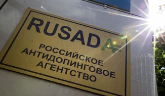 """FILE -The May 24, 2016 file photo shows a RUSADA sign reading """"Russian National Anti-doping Agency"""" on a building in Moscow, Russia.  The World Anti-Doping Agency is due to vote Thursday Sept. 20, 2018, on possible reinstatement of Russia's anti-doping agency, RUSADA, but opponents feel Russia can't be trusted to reform without first accepting more of the blame. (AP Photo/Alexander Zemlianichenko, FILE)"""