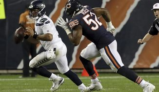 Chicago Bears linebacker Khalil Mack (52) chases Seattle Seahawks quarterback Russell Wilson (3) during the second half of an NFL football game Monday, Sept. 17, 2018, in Chicago. (AP Photo/Nam Y. Huh)