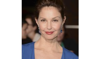 "FILE - In this March 18, 2014 file photo, Ashley Judd arrives at the world premiere of ""Divergent"" in Los Angeles. A federal judge has thrown out part of a lawsuit Judd filed against Harvey Weinstein that alleges he deliberately derailed her career when she turned him down sexually.U.S. District Judge Phillip S. Gutierrez on Wednesday, Sept. 19, 2018, dismissed the sexual harassment allegation in the lawsuit, ruling that the California law Judd was suing under does not apply to the professional relationship she and the movie mogul had at the time. (Photo by Jordan Strauss/Invision/AP, File)"